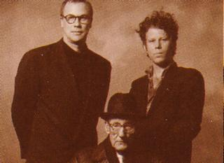 Left to right: Robert Wilson, William Burroughs and Tom Waits, photographed around the time of the original German production. (Burroughs is sitting down, by the way. He's not an amputee or anything.)