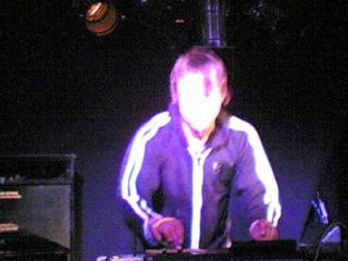 13/07/2005, 21:59. Kid Carpet live at Bar Academy, Islington. He does have a face, honestly, it's just the lighting.