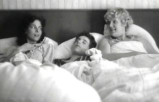 There's some debate amongst film buffs as to whether the character of Hermann Simon is meant to be some sort of surrogate for the director Edgar Reitz. While you're making your mind up on that one, here's a picture of the teenage Hermann (Jorg Richter) having three-in-a-bed sex with Hunsruck hotties Klarchen (Gudrun Landgrebe) and Lotti (Gabriele Blum), from the first 'Heimat'.