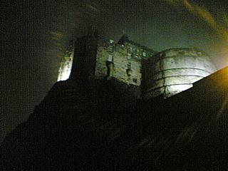 Edinburgh Castle, under the combined cover of night, fog, and how drunk I was when I took the photo. (Or it may have been The BBG who took it. I'm honestly not sure.)