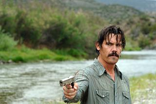 A shameless bit of pandering to The Belated Birthday Girl: Josh Brolin in No Country For Old Men, shooting a dog