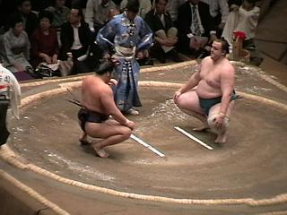 Baruto stares down Tochiozan, shortly before giving him a damn good thrashing
