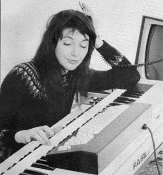Kate Bush and her first sampler. Probably past the stage of trying to make tunes out of her own fart noises by now.