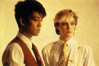 Ryuichi Sakamoto and David Sylvian, looking sadly at two different things