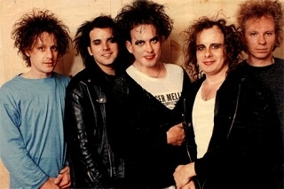 All I seem to have done in the photo captions this time is just be rude about how people look, so let's have a nice smiley picture of The Cure to... oh.