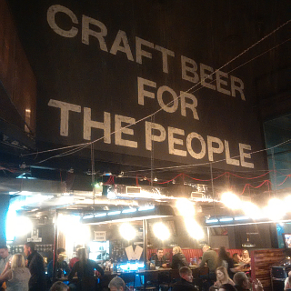 A large part of the upstairs bit of BrewDog Milton Keynes appears to be occupied by a bloody enormous advert for itself.