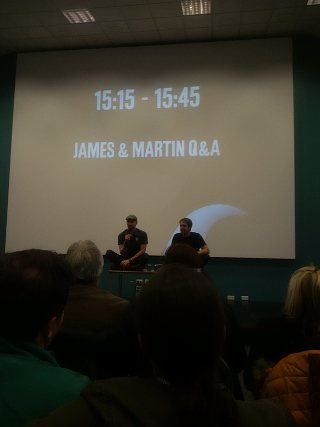 James and Martin, sitting on tables, because that's what DISRUPTORS do