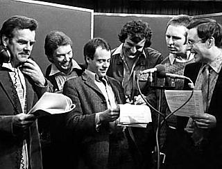 Cast photo from the second series of HHGTTG, circa 1980. Left to right: David Tate, Alan Ford, Geoffrey McGivern, Douglas Adams, Mark Wing-Davey and Simon Jones