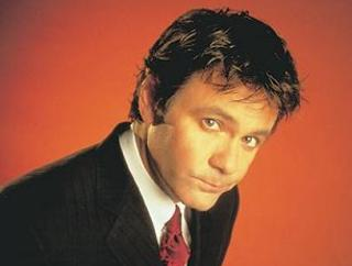 Paul McDermott. In a suit. I remember him when he used to gaffer tape wall clocks to hippies, you know.