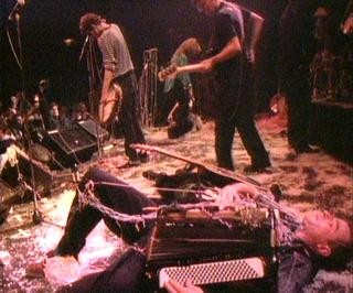 James Fearnley taking it easy at the climax of the Pogues' show on St Patrick's Day 1988